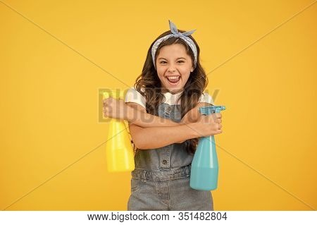 Domestic Cleaning For You. Happy Domestic Helper On Yellow Background. Cute Little Girl Hold Spray B