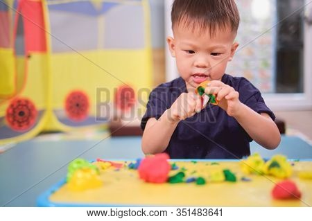 Cute Little Asian 2 - 3 Years Old Toddler Boy Child Having Fun Playing Colorful Modeling Clay / Play