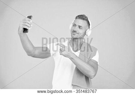 Hand Selfie. Handsome Man Point Finger At Selfie Camera In Smartphone. Happy Sportsman Smiling Take