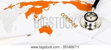 Novel Covid-19, Wuhan Virus Concept From China. Text Phrase Coronavirus On World Map With Orange Cou