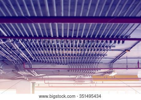 Blurry Picture Of Electrical Conduit And Cabling. Blurry Image For Construction Background.