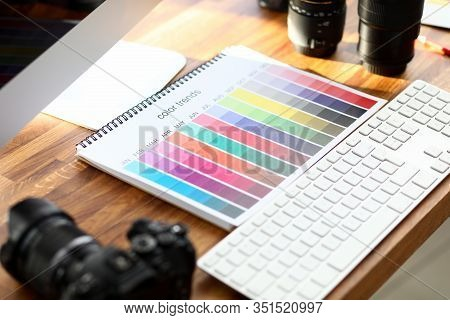 Color Calendar Book With Color Trends Sign On Designer Wooden Table Closeup Background. Color Proof