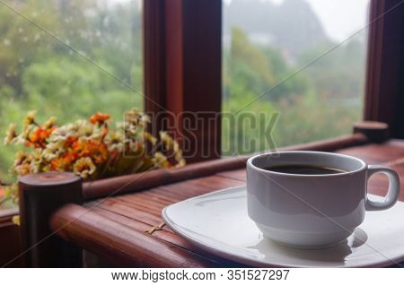 A Cup Of Coffee On An Old Bamboo Table With Nature Mountain View And Flowervase