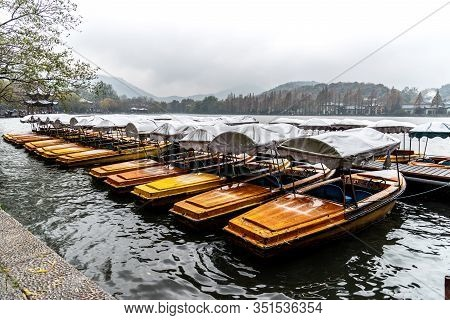 In Winter, Boat Docked Near Leifeng Pagoda At Xihu West Lake In Hangzhou, China