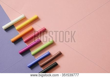 Colorful Pastel Crayons On Pink Geometric Background With Copy Space. Art, Drawing Concept