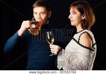 A Man And A Woman On A Black Background, A Man Drinking Beer And A Woman Drinking Champagne