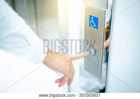 Male Forefinger Pressing On Up Button Of Elevator For Blind Or Disability People (disabled Lift). Ha