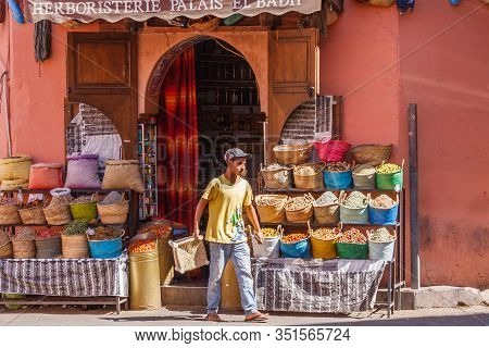 Marrakech, Morocco - September 9th 2010: Vendor Walking Out Of His Herbalists Shop. The Country Is F