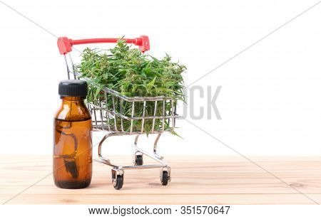 Cannabis With Cannabidiol Extract On Table