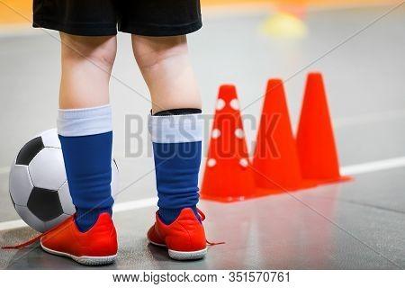 Children Playing Football In School Gymnasium. Indoor Soccer - Futsal Training For School Kids. Foot