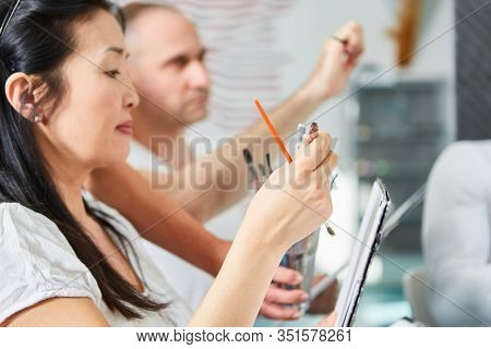 Young Asian woman as art student learns painting in a seminar of art academy