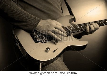musician rock guitarist playing a guitar