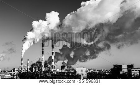 Black And White Industrial Landscape, Swirling Jets Of Smoke From Factory Chimneys Poison The Air Wi