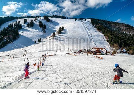 Ruzomberok, Slovakia - February 15: Ski Lift And Slope With Skiers And Snowboarder In Resort Malino