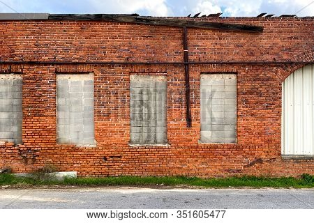 A Boarded Up Old Red Brick Building