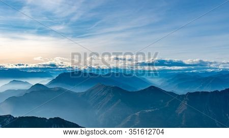 Beautiful Captivating Landscape Of The Layered Misty Hazy French Alps Mountain Range In Alpes-mariti