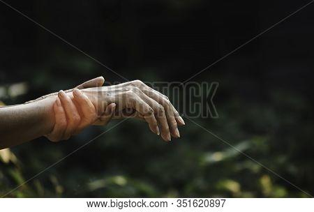 Female Holding Wrist. Pain In A Woman Wrist. Woman Massaging Painful Wrist. Pain Concept.