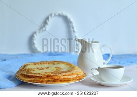 Pancake Week: Thin Pancakes With Jug And Tea On White Table.french Crepes .thin Pancakes And Glass O