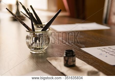 Antique Feather Pens, Old Letters, Vintage Postcards And Ink At The Wooden Table. Retro Nostalgic Se