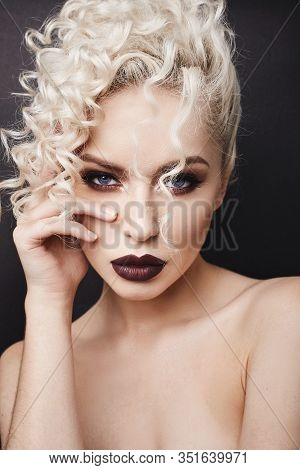 Cropped Portrait Of A Young Woman With Bright Makeup, Blue Eyes And Curly Blond Hair. Model Girl Wit