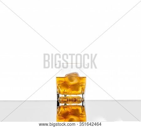 Glass With Alcoholic Drink With Ice, On The Rocks, Whisky, Rum, Cognac, Brandy, Scottish, White Back