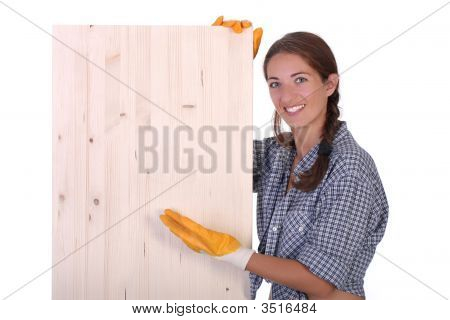 Woman Carpenter Holding Wooden Plank