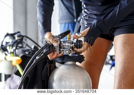 Diving Equipment Close-up. Preparation Before The Dive. Silver Oxygen Tank.