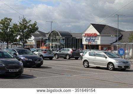 Wilmslow, England, 20 August 2019: View Of The Handforth Dean Retail Park And Carpark Near Wilmslow