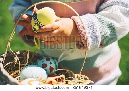 Colorful Easter Eggs In Basket. Kids Hunt For Eggs Outdoors.