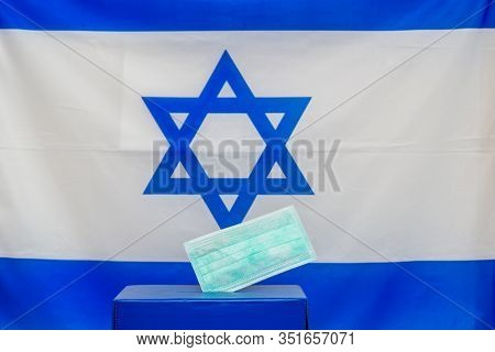 Elections Israel. Disposable Face Mask In A Box For Ballot In Election On Israel Flag Background. Is