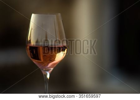 Picture In Low Key Of Glass Of Rose Wine With Reflection Of Old Stone Traditional Provencal House In