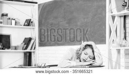 Woman Tired In School Classroom. School Pedagogue Stressful Occupation. Tired Tutor Fall Asleep At W