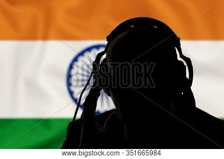 Silhouette Of A Man With Headphones On The Background Of The Flag Of India, Eavesdropping On A Conve