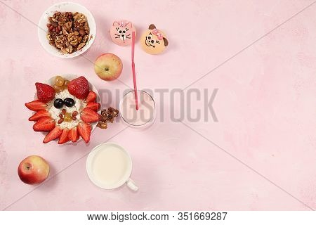 Granola, Cottage Cheese With Yogurt And Fresh Strawberries And Grapes On A Light Table. The Concept