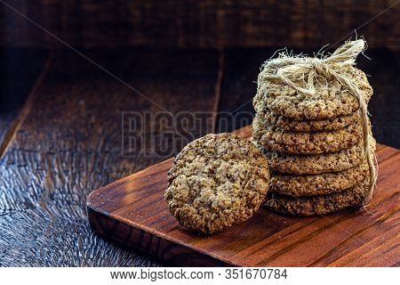 Wholemeal Biscuit Made In A Wing, Stacked On A Rustic Wooden Background.