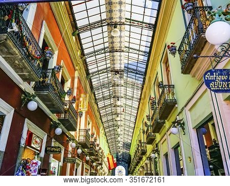 Puebla, Mexico - January 5, 2019 Shopping Arcade Restaurants Zocalo Puebla Mexico. Arcade And Shops