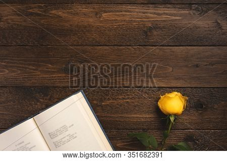Romantic Concept. Open Book With Poems And Rose, On Wooden Background. Flat Lay, Top View, Copy Spac