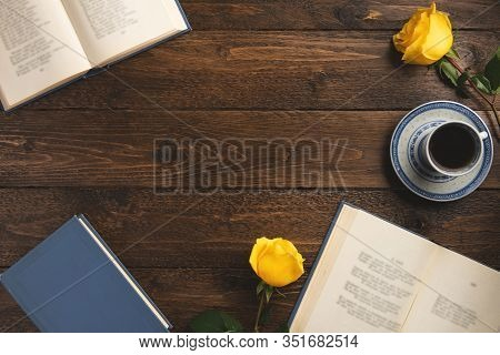Books With Poems, Cup Of Coffee, Roses, On Wooden Background. Flat Lay, Top View, Copy Space.