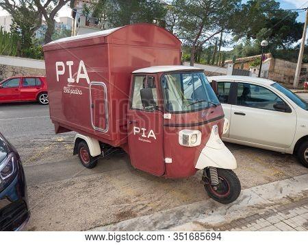 Piaggio Ape 400classic, Red Three-wheel Transportation. The Piaggio Ape Is A Three-wheeled Light Com
