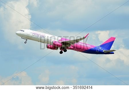 Warsaw, Poland. 26 July 2018. Airplane Ha-lxn - Airbus A321-231 - Wizz Air Taking Off From The Warsa
