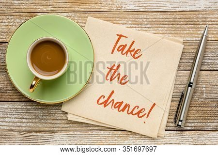 take the chance reminder note - motivational handwriting on a napkin with a cup of coffee, business or personal development concept