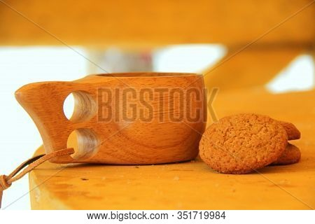 Still Life Of A Wooden Mug And Cookies On A Wooden Table. Soft, Natural, Warm Colors. Eco Friendly C