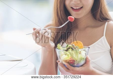 Healthy Food Healthy Lifestyle With Young Happy Woman Eating Green Fresh Ingredients Organic Salad.