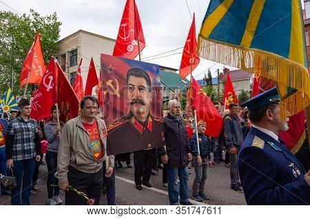 Anapa, Russia - May 9, 2019: People Carry A Portrait Of Joseph Stalin Along The Streets Of Anapa, At