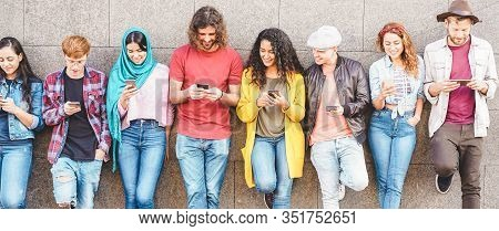 Group Of Millennial Friends Watching Social Story On Smart Mobile Phones - People Addiction To New T