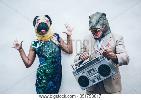 Crazy Senior Couple Dancing For Party Wearing T-rex And Chicken Mask - Old Trendy People Having Fun