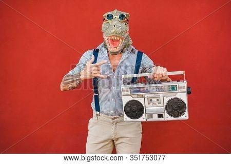 Crazy Senior Man Dancing Rock Music Wearing T-rex Mask - Tattoo Trendy Guy Having Fun Listening Musi