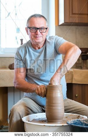 Professional Ceramist Working With Loam At Home Studio. Handmade And Small Business Concept.