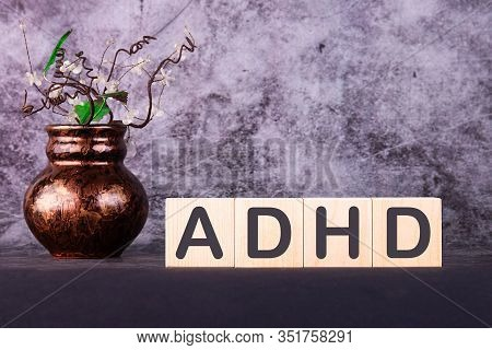 Adhd Abbreviation On Adhd Cubes On A Grey Background. Close Adhd - Attention Deficit Hyperactivity D