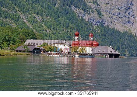 In The Centre Of The Picture Is The Pilgrimage Church Of St. Bartholomew At Koenigssee And A Popular